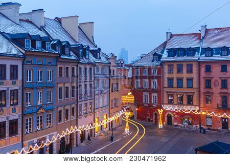 Old Town Market Place With Colorful Houses During Morning Blue Hour, Warsaw, Poland.