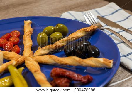 Close Up Of Mediterranean Antipasti Plate With Two Kinds Of Green Black Olives Fresh Dried Tomatoes