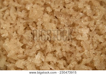 Closeup Background Of Brown Salt Crystals In A Heap.
