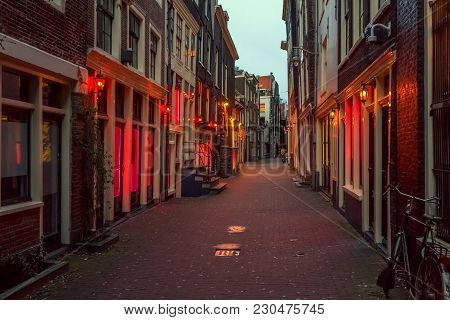 Red Light District In Amsterdam, The Netherlands, Night View. Windows And Doors Where Prostitutes Wo