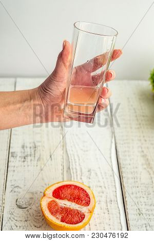 Freshly Squeezed Grapefruit Juice In Glass Glass Fougeres In The Hands Of A Girl With Beautiful Nail