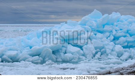 Beautiful Turquoise Blue Ice Flows On The Shore Of Georgian Bay In Meaford, Ontario, Canada. The Ice