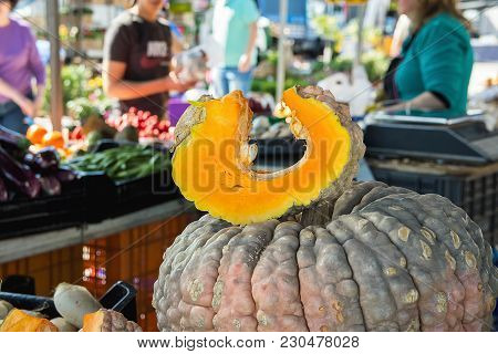 Big Bumpy Beautiful Dark Pumpkin With Cut Out Wedge Slice. Dent Texture Seeds. Farmers Market. Thank
