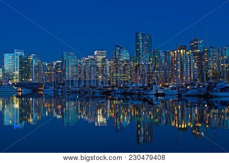 Vancouver City Skyline At Night In British Columbia, Canada. Modern Building And Waterfront Marina W