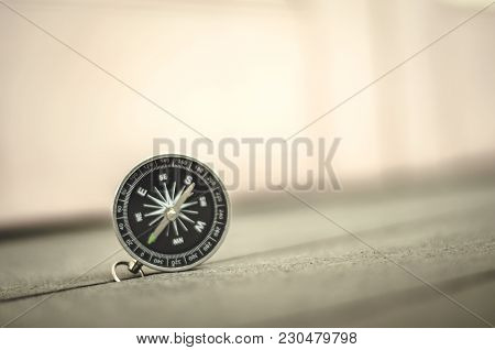 Travel Discover And Direction Concept, Vintage Look Compass On Wooden Background