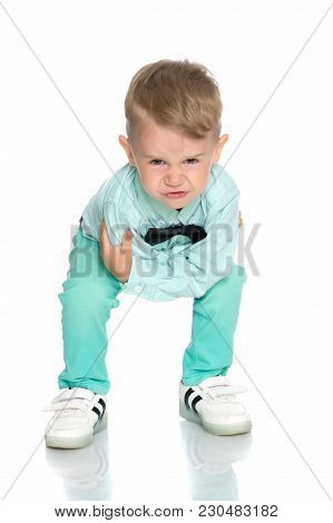 Little Boy Emotionally Waving His Hands In The Studio On A White Background. The Concept Of A Happy