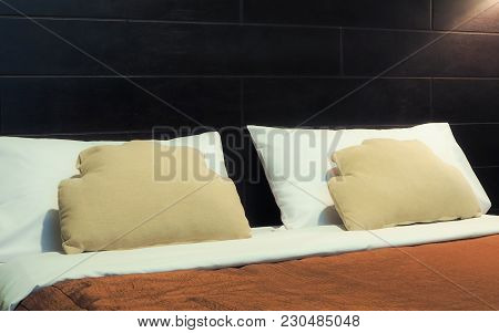 Image Of Comfortable Pillows And Bed In The Hotel Room.