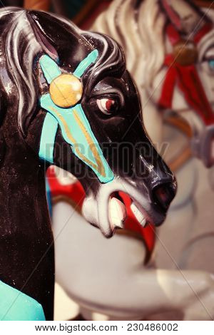 A Carousel Horse Up Close Sticking His Tongue Out.