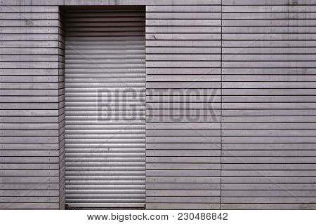 The Close-up Of The Wooden Paneling Of A Wall Of A Closed Shop With Lowered Door Jalousie.