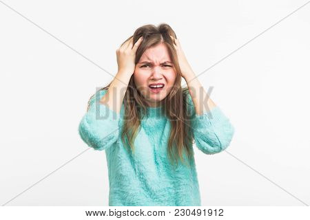 Concerned Scared Woman On White Background In Studio