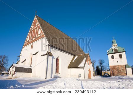 Ancient Lutheran Cathedral Of The 15th Century In The City Of Porvoo In The Sunny February Afternoon