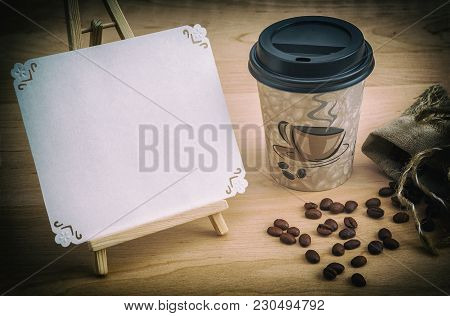 Creative Image Of Coffee Beans And A Cup On A Wooden Surface, Disposable Tableware, The Name