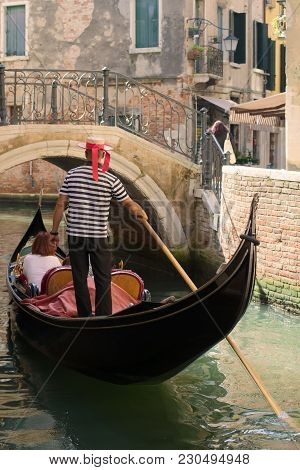 Venice, Italy - September 28, 2017: A Walk On The Gondola Along The City Canal