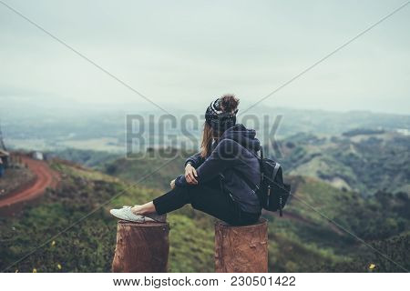 Young Woman Traveler Sitting And Looking View Of Nature, Relaxation On Vacation Trip