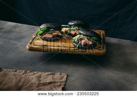 Set Black Burger Beef Medium Rare, Spinach, Green Sauce Microgreens