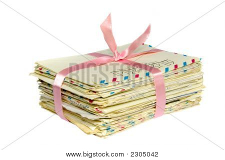 Stack Of Old Letter Bonded With Pink Ribbon Isolated On White