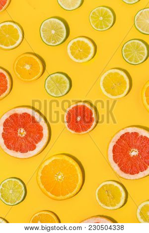 Flat Lat Top View Sliced Citrus Fruit Yellow Background