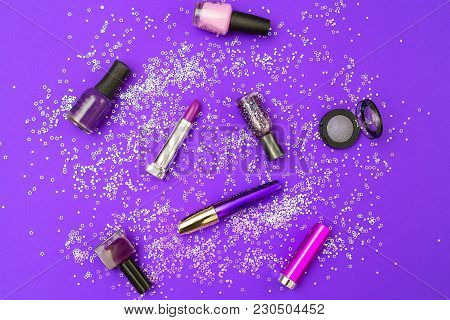 Make Up Violet On An Ultra Violet Background With Sparkles. Flat Lay
