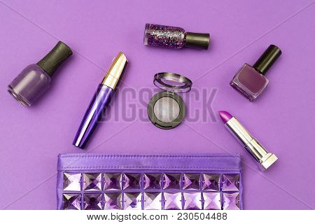 Ultra Violet Cosmetics On An Ultra Violet Background. Top View