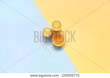 Freshly Squeezed Orange Juice On A Colorful Background. Copy Space