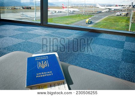 Tbilisi, Georgia, 2017-12-07: Ukrainian Foreign Passport With Tickets Is On Chair At The Airport Wit