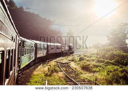 NUWARA ELYA, SRI LANKA-DEC 29. 2016:Train goes through tea plantation in Nuwara Eliya district on Dec 29, 2016,  Sri Lanka. Tea production is one of the main sources of foreign exchange for Sri Lanka