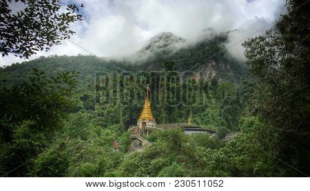 A Solitary Temple Hidden In The Mountains Of Northern Thailand While The Clouds Roll In And Conceal