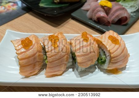 Seared Fresh Raw Salmon Sushi Nigiri Roll With Fish Roe On White Plate Closeup Macro