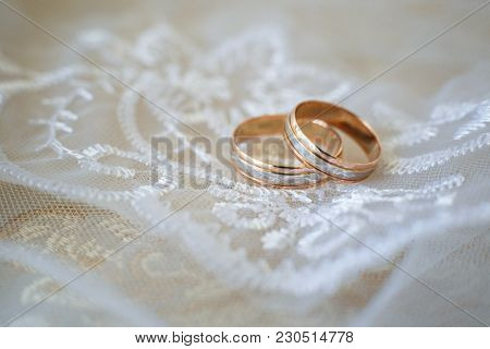 Two Wedding Rings On A Textured Background