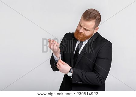 Elegant Successful Man In Suit. Business Man Buttons Up The Button