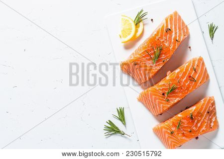 Salmon Fish. Uncooked Salmon Fillet With Lemon Sea Salt And Rosemary On White. Top View.