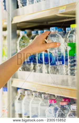 Woman's Hand  Pick Product From  Convenience Store Refrigerator Shelves