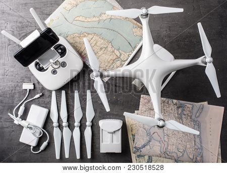 Drone equipment. Remote control, drone, screw, map on gray background. Aerial shooting concept. Top view