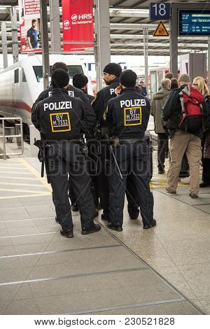 Munich,germany-march 10,2018 : A Group Of Riot Police Officers Wait For Football Fans From Hamburg T