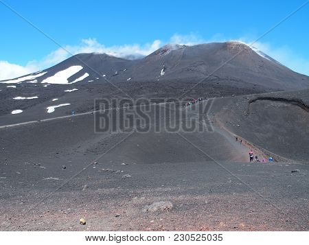 Etna Summit At Sicily In Italy With Touristis, Panoramic Landscapes Of Lava And Massif Of Mount, Tal