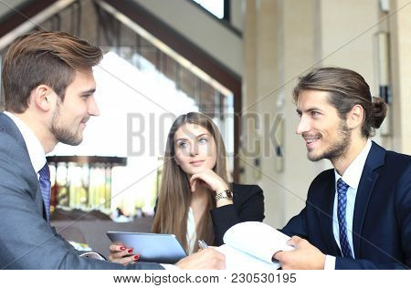 Businessman Smiling Happily As His Business Partner Finally Signing Important Contract