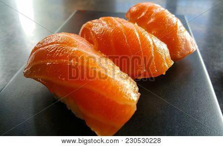 Sake Nigiri Sushi - Close Up Shot - Fresh Salmon Photo