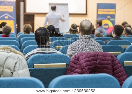 Male Presenter Holding A Conference In Front Of A Group Of Listeneres In A Congress Hall. Presenting