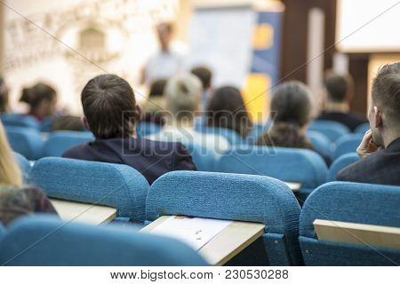 Meetings Concepts. Male Presenter Holding A Conference In Front Of A Group Of Listeneres In A Congre