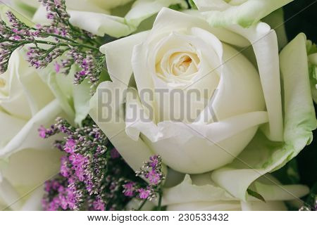 Beautiful Sweet White Roses Bouquet In Close Up View Macro Concept. Luxury Romantic Gift Or Present