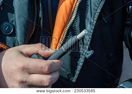 A Heat-not-burn Tobacco Product Technology.man Holding In One Hand Smoking Module Before Smoking.