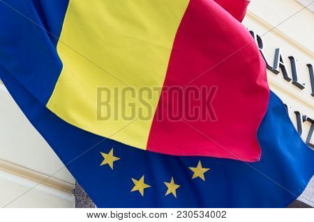 Flag Of The European Union Covered With The Romanian Flag. Political Relations And Union Concept.