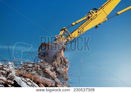 Demolition Crane Dismantling A Building To Rubble