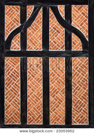 Traditional English inclined sloping Brick wall
