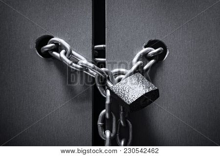 The Lock With A Chain On The Door Leafs