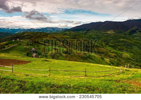 Agricultural Fields In Mountains. Beautiful Carpathian Landscape With Mountain Ridge In The Distance