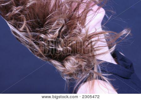 Young Woman Throwing Hair Back