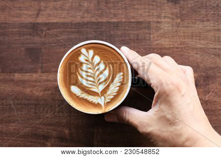 Top View One Hand Handle Hot Cappuccino Coffee Cup With Beautiful Foam Of Latter Art