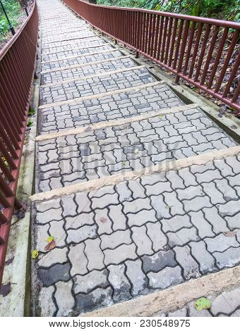 Brick Pathway With The Metal Railing Of The Nature Trails,top Of The Mountain In The Early Morning W