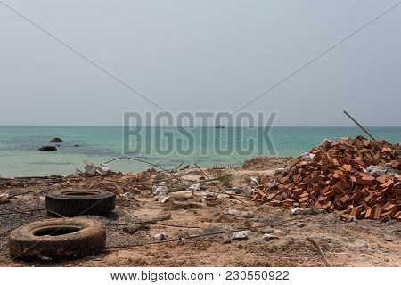 Ocean Shore Polluted By Demolition Waste After Construction Works On Beautiful Wild Island. Foregrou